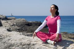 YOGA ON THE ROCK Stock Image