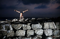 Yoga on the rocks Royalty Free Stock Image