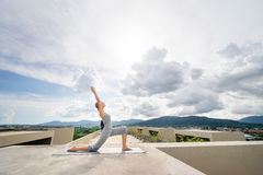 Yoga on rooftop. Stock Images