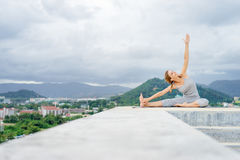 Yoga on rooftop. Royalty Free Stock Image