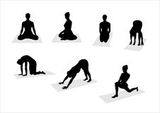 Yoga's  silhouettes - 2. Black yoga's silhouettes on white background Royalty Free Stock Photography