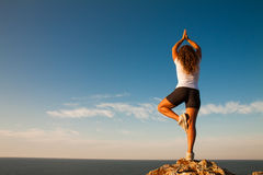 Yoga sana de la práctica de la mujer Fotografía de archivo