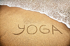 Yoga on the sand Stock Photo
