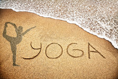 Yoga on the sand Stock Image