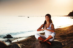 Yoga on sea. Yoga seat in lotus on sea Royalty Free Stock Images
