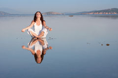 Yoga at sea Stock Photography