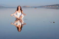 Yoga at sea Stock Photography