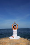 Yoga by Sea Stock Photography