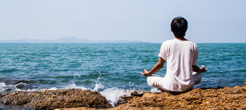 Yoga at the sea Stock Image