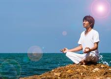 Yoga at the sea Stock Image