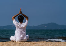 Yoga at the sea Royalty Free Stock Photos