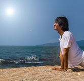 Yoga at the sea Stock Photos