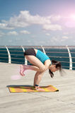 Yoga on the sea background Royalty Free Stock Photos