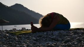 Yoga at sea cost and mountain Turkey stock video footage