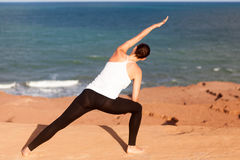 Yoga at the sea side Royalty Free Stock Photos