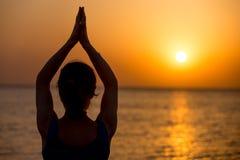 Yoga on the sea Stock Photos