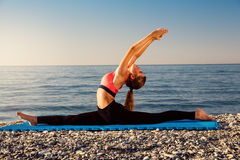 Yoga at the sea Royalty Free Stock Photo