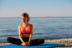 Yoga at the sea Royalty Free Stock Images