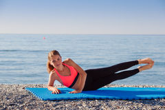 Yoga at the sea Stock Photography