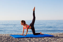 Yoga at the sea Stock Images