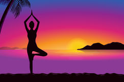 Yoga in seaside at the sunset time. Royalty Free Stock Photo