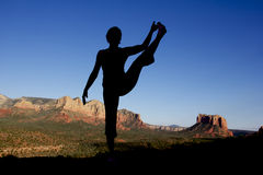 Yoga at Sedona. A woman in a yoga pose near scenic sedona arizona Stock Image