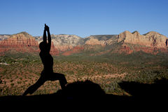Yoga at Sedona. A woman in a yoga pose near scenic sedona arizona Royalty Free Stock Photos