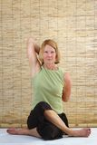 Yoga Senior Gomukasana Stock Photos