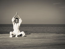 Yoga in sepia kleurentoon Stock Foto