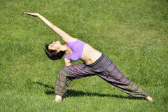 Yoga session. Beautiful woman doing yoga exercises in a tranquil location Stock Photo