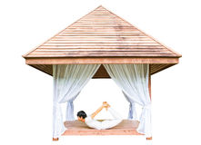 Yoga session in wooden shelter Stock Photos