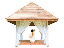 Yoga session in wooden shelter Royalty Free Stock Photos