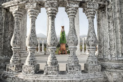 Yoga shirshasana head stand pose. Yoga shirshasana, head stand pose is done by Indian man in green trousers between stone columns at mountain background Royalty Free Stock Images