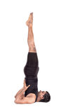 Yoga shoulder stand pose on white Stock Photo