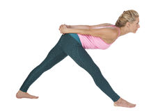 Yoga_side front over bend_high Stock Photo