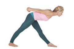 Yoga_side front over bend_low Royalty Free Stock Image
