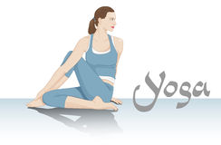 Yoga side twist. Young woman practicing yoga asana Stock Photography