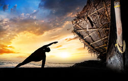 Yoga silhouette on the beach Stock Photo