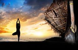 Yoga silhouette on the beach Stock Photos
