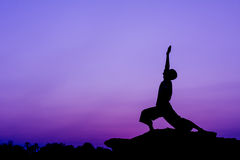 Yoga. Silhouette of a man in Yoga posting Royalty Free Stock Photo