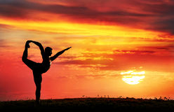 Yoga silhouette Natarajasana dancer pose Stock Photo