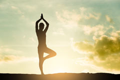 Yoga silhouette. Outdoor at sunset Royalty Free Stock Photography