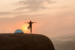 Yoga silhouette on sunset time Stock Image