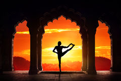 Yoga silhouette in temple Stock Photos