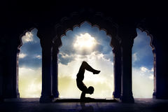Yoga silhouette in temple royalty free stock photography
