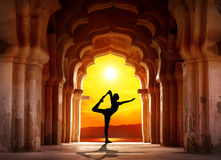 Yoga silhouette in temple royalty free stock image