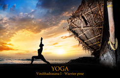 Yoga silhouette warrior pose near boat Royalty Free Stock Photography