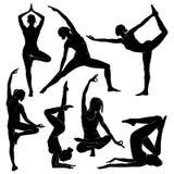 yoga Silhouetten van yogameisjes Cijfers van Vrouwelijke Fysieke Cultuur van Yoga stock illustratie