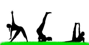 Yoga silhouettes Royalty Free Stock Photo