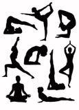 Yoga silhouettes - vector. Yoga silhouettes in some asana - vector Stock Photos